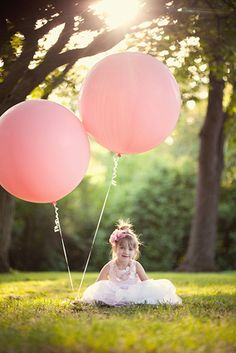 little girls and pink balloons cute for 1st birthday pictures