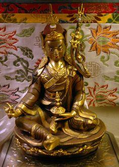 https://flic.kr/p/axWwWu | Statue of Padmasambhava, 8th century saint who brought Buddhism to Tibet, floral Tibetan style silks, khata (kata), ornate box, Seattle, Washington, USA