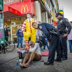 Photos: Cops Threaten To Ticket Banksy's Ronald McDonald Shoe Shine Boy. Better Out Than In, Banksy in NYC, Oct. 23, 2013