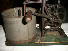 antique food chopper from the late 1800's    It chops downward while the canister rotates  The piece is constructed of cast iron, tin and wood  Measures 17x12x13