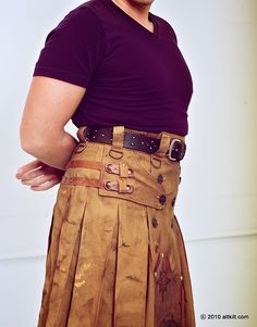 Steampunk kilt, love the leather strap placement and length.