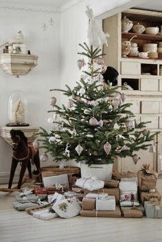 sweet little tree with vintage ornaments and simply wrapped presents