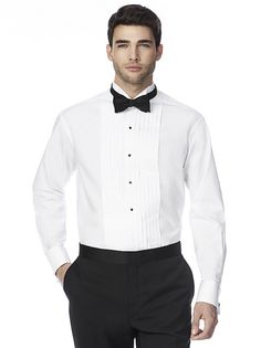 The Graham wing collar pleated front tuxedo shirt is fitted for a modern look. It features a 4-button studded front with full front pleats stitched to the bottom. The unbreakable buttons are cross stitched and extra buttons are provided. The tuxedo shirt is made from 100% super soft cotton with a comfort collar extender. The fit is an exact neck size with adjustable sleeve length. The sleeve placket has a button to ensure a smooth tapered look from shoulder to wrist.