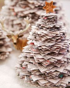 Create shimmering stacked Christmas tree descorations with old newspaper.