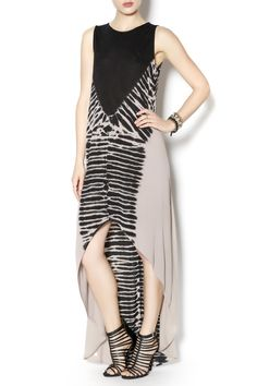 Long sleeveless tie-dye dress with black top and high-low bottom.