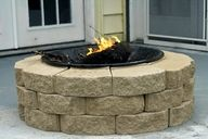 Easy fire pit; store bought fire pit, add bricks from your local home depot/lowes, stack them around the pit to finish!