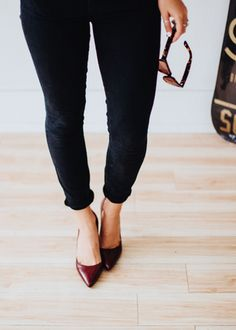 Finally, we can pull out our corduroys. Caroline Sleeper styles these classic black ankle cords with a pair of chic burgundy D'Orsay pumps | Banana Republic