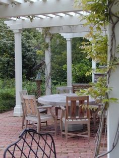 Perfect! Brick patio with our giant wisteria trained onto a slatted porch cover like this.