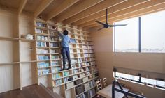 In earthquake-prone Japan, a wall full of books might seem like a disaster waiting to happen. Rather than capitulate to Mother Nature however, the owners of this Yokohama home found a way to safely put their massive library of books on full display without fear of collapse. Shinsuke Fujii Architects designed the Bookshelf House that features angled earthquake-resistant bookshelves easily accessible by children and the elderly without a ladder.