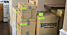 Pack Like a Pro: 23 Moving Tips to Keep Your Sanity (And Stuff) Intact : moving boxes stacked
