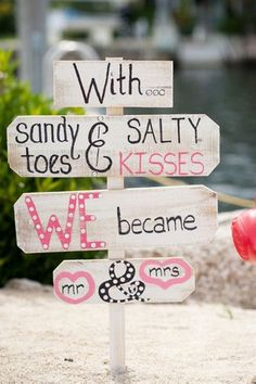 With sandy toes & salty kisses, we became Mr. & Mrs. - colorful beach wedding sign