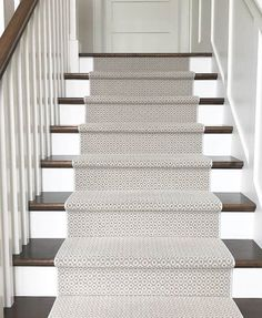 Patterned stair runner in blue and cream on wood tread stairs with white risers. Tiled Hallway, Tile Stairs, Wood Stairs, Upstairs Hallway, Best Carpet For Stairs, Carpet Staircase, Carpet Runners For Stairs, Stairs In Living Room, Living Room Carpet