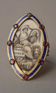 Mourning ring; gold; marquise bezel studded round border with garnets in settings over bands of blue and white enamel; contains figure of Britannia(?) sitting on stern of vessel on which is a name, and wreathing the picture of an admiral; lion at her feet with paw on dead dove. No maker's mark.