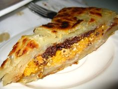 Roti prata manis - pan fried layer bread with condensed milk, cheddar cheese, ground peanut, and chocolate (5.24.10) | Yelp