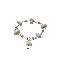 £87.00 peanut pearl and pink topaz 7mm rondells main. https://www.thegemladyinlondon.com/product/pearl-pink-pearl-bracelet/
