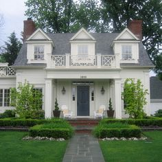 Great curb appeal: pathway, landscaping, symmetry, lighting, house numbers, door color, welcoming porch