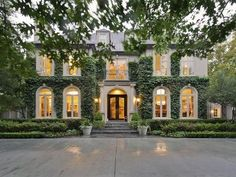 Like the parking area, the ivy, the greenery around the house, the steps and walkway to house and all of the windows