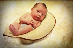 Newborn pictures with a cowboy hat...definitely trying!