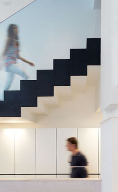 Office Fantastic: Paul Crofts Defies Gravity at London's Fold7 | Lacquered cabinetry stands under the stairs. #interiordesign #interiordesignmagazine #projects #offices