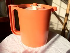 Vintage 70s Tupperware Go-Between 1.5 Qt. Spill-Proof Pitcher - Flame Orange by thevintagedude on Etsy, $14.00