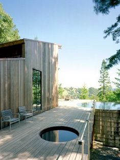 Rather than a big, bulky appliance taking up room on the deck, consider what architect Olle Lundberg did with his Sonoma retreat—he sank the tub below the deck, leaving an unobstructed view of the trees beyond.