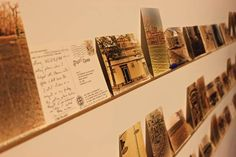"""The exhibit is interactive — viewers can pick up each postcard and read the letter on the back. According to Lubar, the ability to interact with the exhibit is key. """"It allows for story-telling between people,"""" he wrote. """"The writer is talking to the reader."""""""