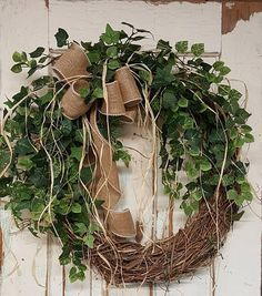 Handmade item  Materials: grapevine wreath, glue, wire, wired burlap, realistic fern, realistic greenery  Made to order Ships from United States  Questions? Contact shop owner Item details  BEST SELLER This beautiful burlap front door greenery wreath is the perfect simple accent for your door or interior. A wired burlap ribbon makes a simple bow. FRONT DOOR WREATH  Average Diameter: 22 (tip to tip) This wreath will be created on a grapevine wreath measuring approximately 18 Indoor/ Shelt...
