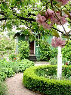 Green cottage in a garden by Poppins' Garden, via Flickr