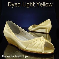pale yellow shoes. add a navy bow or cute button?