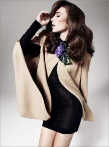 40s fashion - black dress, camel-colored wrap, wavy hair
