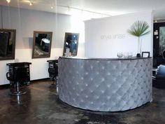 To welcome clients to this upscale beauty salon, Hines created a custom-made quilted reception desk in a posh charcoal hue.