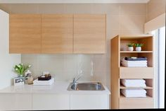 Pacific - Images | McDonald Jones Homes. White and timber cabinetry in laundry