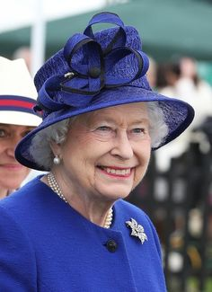 Queen Elizabeth. I love this hat, the shape and the texture.  This shade of blue frames her face beautifully and complements her sparkling blue eyes as well as her complexion and white hair. She looks like a beautiful jewel. Marvelous!