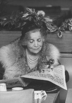 A French woman reading a paper, Paris, 1959.