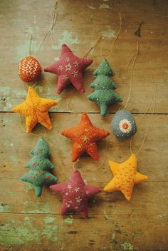Handmade Christmas tree ornaments by Willowynn. Embroidered fabric stars, and trees