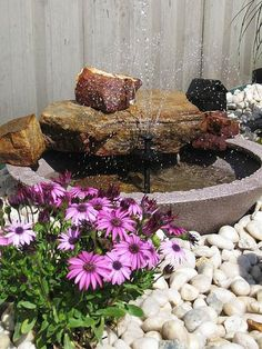 Advertisement Thrifty Fountain Rate My Space user AussieAngel created this DIY water feature on a tight budget, purchasing only a solar water pump. Surrounding stones and flowers make it an attractive part of the landscaping