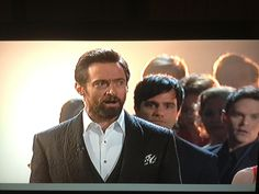 He's there! The Phantom of the Opera! Right there, lookin' over Hugh Jackman's shoulder. Heehee!