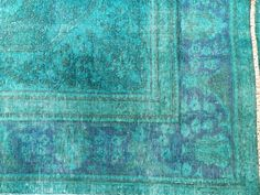 Hand knotted pile vintage carpet re-dyed in brilliant tones. This Persian rug was repeatedly washed and clipped and left to sun dry. This process renders the colors soft and the pile short and distressed. Once faded and distressed, the rug is over-dyed in a contemporary chromatic expression. A unique and one-of-a-kind revolutionary work of up-cycled…