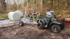 Using a quad bike to reverse the bale trailer. ATV bale trailer moves round bales of hay with a quad bike. http://www.fresh-group.com/atv-bale-trailer.html