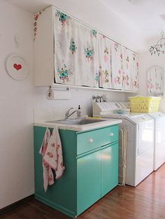 the vintage fabric curtains and the teal wash basin!