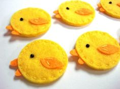 Felt chicks; would look cute hanging in the window from embroidery floss or thin ribbons. (Flickr)