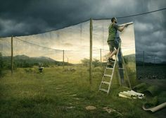 Erik Johansson is an expert at using Adobe Photoshop to take real photographs and turn them into something magical. The man on the ladder in the photograph below appears to not like the dark and dismal view of the landscape in the background. So what does he do? Well… instead of complaining about it, he prints out some banners of a more pleasant scene and hangs them on a wire to completely change the view. The trick with Erik's work is that he takes many photographs with the same…