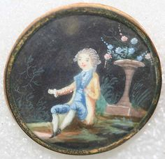 Ca 1775 Button of hand painted ivory, under glass, set in metal. French. One of a set of five with different, but related images of young men.