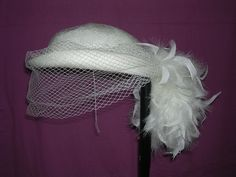 Marida cream basket weave effect hat with net and feathers £3.70 (3B) +2.99PP