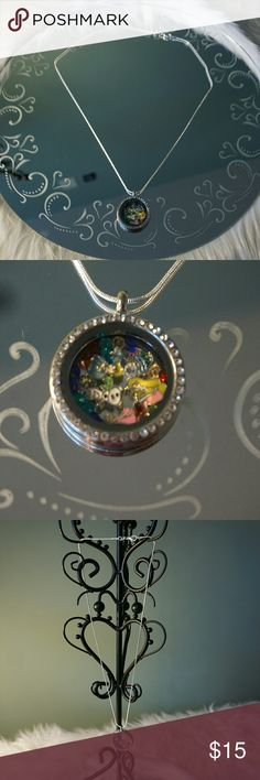 Disney Princess Floating Charm Locket Very cute Disney Princess Floating Charm Locket. 925 mark 22 inch necklace. Ariel, Cinderella, Aurora  (2) and Olaf the frozen snowman and multi colored lab created locket crystals. Comes with Della Ama tag and small velvet jewelry bag great as gift. FL2 Della Ama Jewelry Necklaces