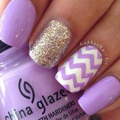 Purple nails with a gold accent nail. Love the zig zag pattern