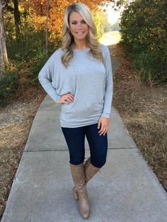 This dolman sleeve top is the perfect base layer for outfits. Soft and stretchy material, round neckline, ruched sides, and fitted sleeves. The dolman style is flattering on any body type! Add one of