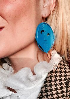 Shop now. New from J.W.Anderson, this Surrealist earring is crafted from cobalt blue plated enamel with gold-plated hoop and hook. Featuring an embossed and cut moon face emblem; reminiscent of Un Chien Andalou; this statement piece is equal parts Henri Matisse and Jean Cocteau.