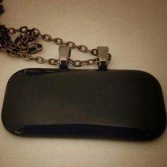 Black rectangular glass pendant with 2 gunmetal colored bails