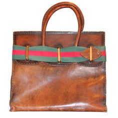 Italy 1960's This Gucci bag has an incredible patina, beautiful top stitching, and is in classic Birkin form. You have to love it!